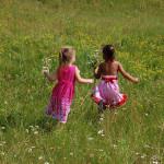 little girls in open field